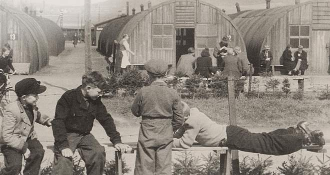 Children outside Nissan huts in the Friedland camp, c. 1950